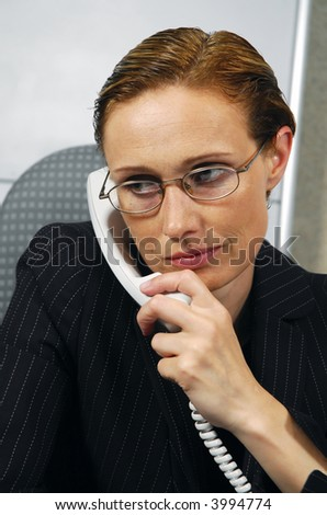 40 years old business woman makes a call - stock photo