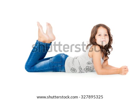 6 years old child in jeans lying on the floor - stock photo