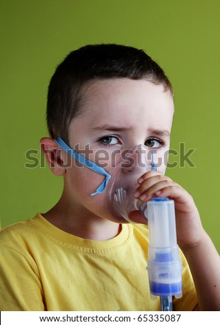 5 years old child taking respiratory, inhalation therapy. - stock photo