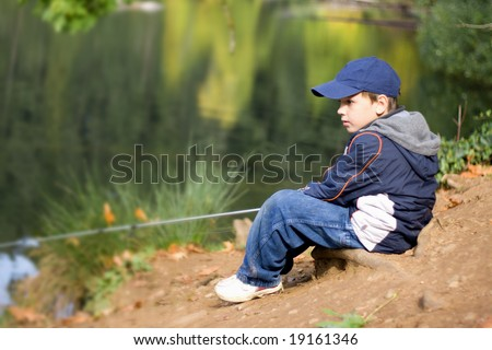 6 years old fisher boy - stock photo