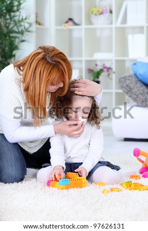 3 years old girl  and his mother - flu season - stock photo