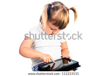 3 years old girl gaming with tablet isolated over white - stock photo