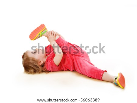 2 years old girl makes pilates - stock photo