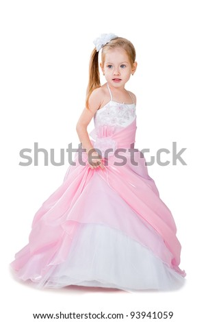 4-6 years old girl wearing gorgeous gown isolated on white studio background - stock photo