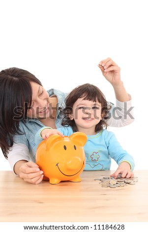 2 years old girl with her mother and piggy bank isolated on white - stock photo