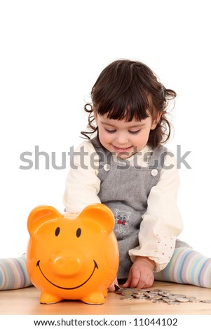 2 years old girl with piggy bank isolated on white