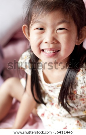 5 years old happy Asian girl smiling - stock photo