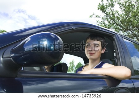 19 years old man driver in a car - stock photo