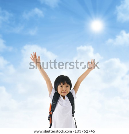 7 years old pan Asian school girl arms up in the air - stock photo