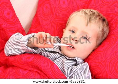 3-4 years old preschooler in bed - sick - stock photo