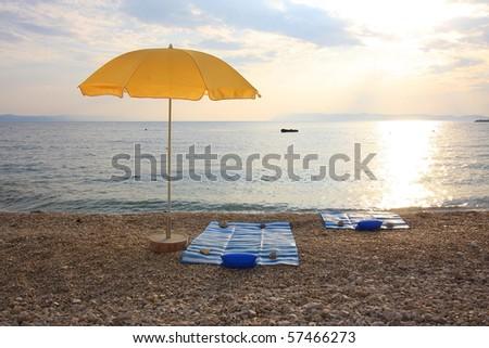Yellow beach umbrella - stock photo