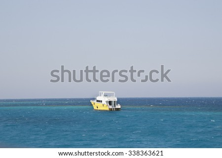 Yellow boat on the sea. - stock photo