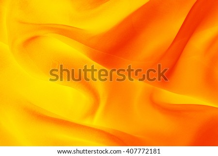 yellow-orange fabric with large folds, bright abstract  background - stock photo