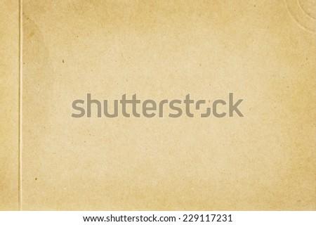 yellowish cardboard texture or background  - stock photo