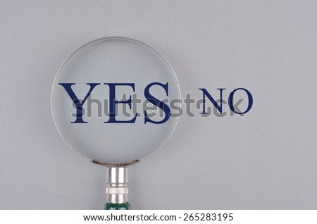 """ Yes No"" text concept with magnifying glass"