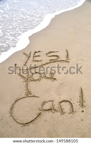 """""""yes you can,"""" a message written in the sand - stock photo"""