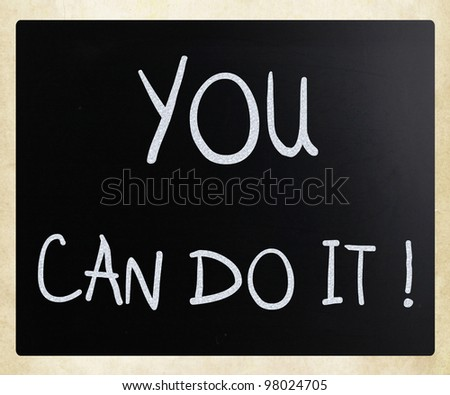 """""""You can do it"""" handwritten with white chalk on a blackboard - stock photo"""
