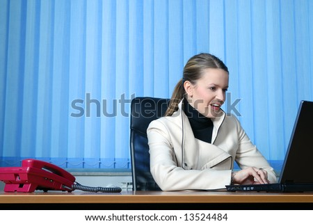 .young and happy businesswoman typing on laptop keyboard