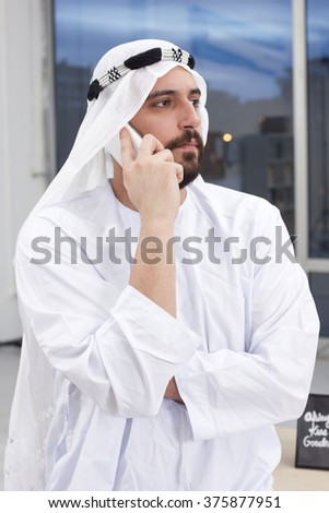 Young Arabic Business man talking on the phone