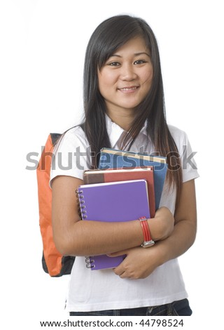 Young attractive female Asian student holding school books - stock photo