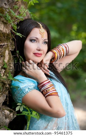 young beautiful brunette in the indian national dress - stock photo