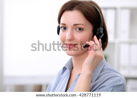 Young beautiful business woman in headset. Call center. - stock photo