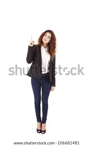 Young beautiful female business executive pointing at copyspace - stock photo