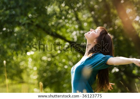 young beautiful girl on a meadow - stock photo