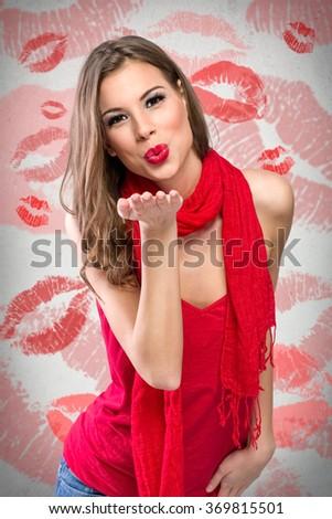 Young beautiful girl sending kiss - stock photo