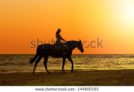 young  beautiful girl with horse on seacoast - stock photo