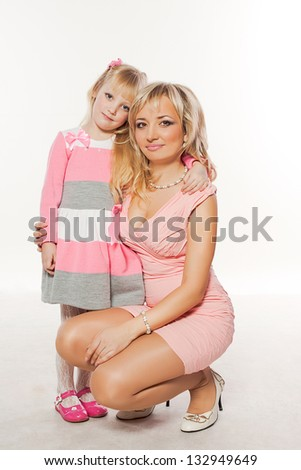 Young beautiful mother and her little daughter - stock photo