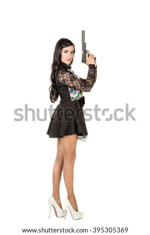 Young beautiful woman holding a handgun. war, army, weapon, technology and people concept. Image on a white background.