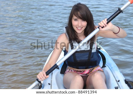 #young brunette in kayak - stock photo