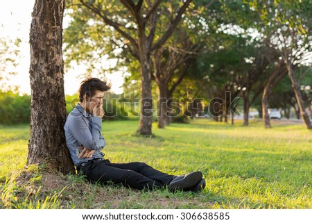 Young business man drowsy after hard work, He needs to rest with nature . - stock photo