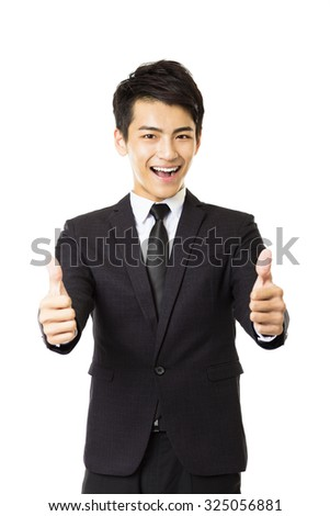 young business man with thumbs up gesture - stock photo