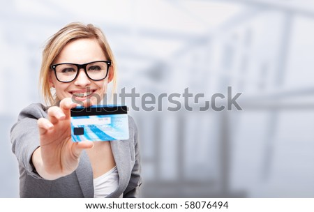 young business woman holding new credit card - stock photo