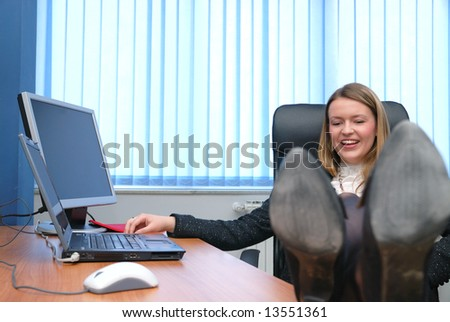 .young business woman relaxing with feet on table