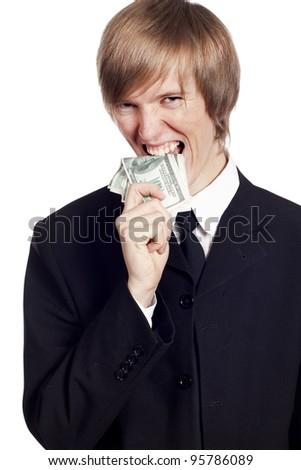 Young businessman biting cash - stock photo