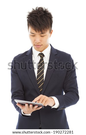 young businessman holding a tablet and touching screen - stock photo