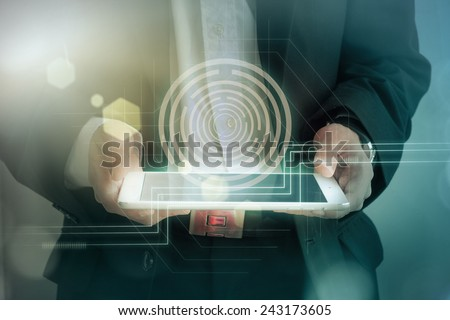 young businessman using digital tablet