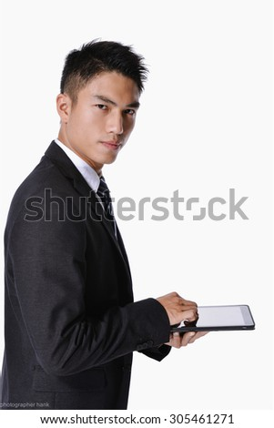 Young Businessman Using Digital Tablet Isolated on white