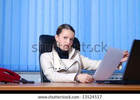 .young businesswoman reading document