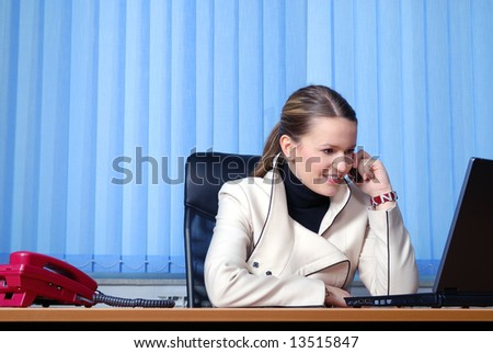 .young businesswoman talking by phone and working on laptop