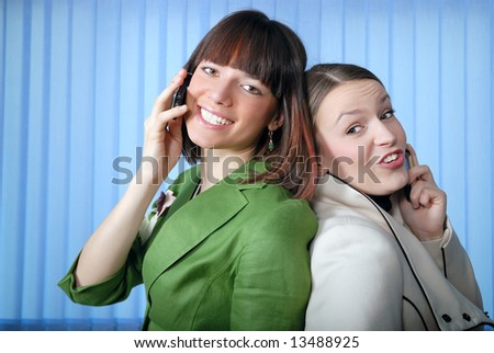 .young businesswomans talking by phone