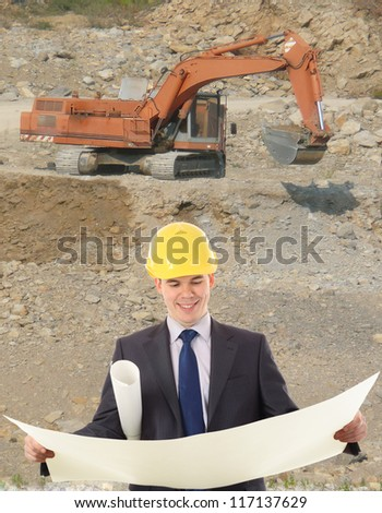 young construction worker with a bulldozer - stock photo