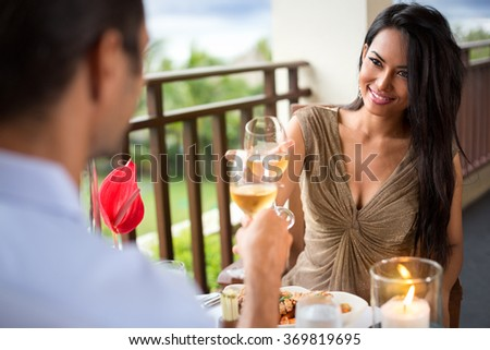 Young couple drinking wine ad toasting during romantic dinner - stock photo