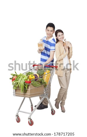 Young Couple Grocery Shopping - stock photo