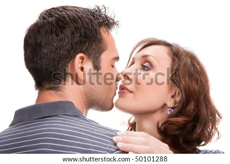 young couple in love, close up, studio shot - stock photo