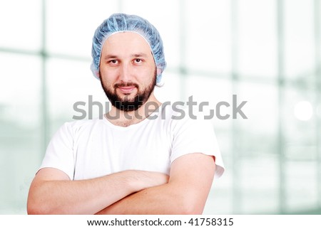 Young doctor in his office - stock photo