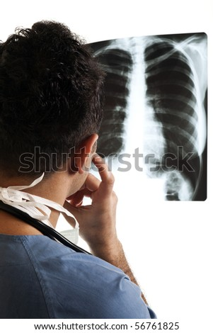 Young doctor looking X-Ray image on isolated white background - stock photo
